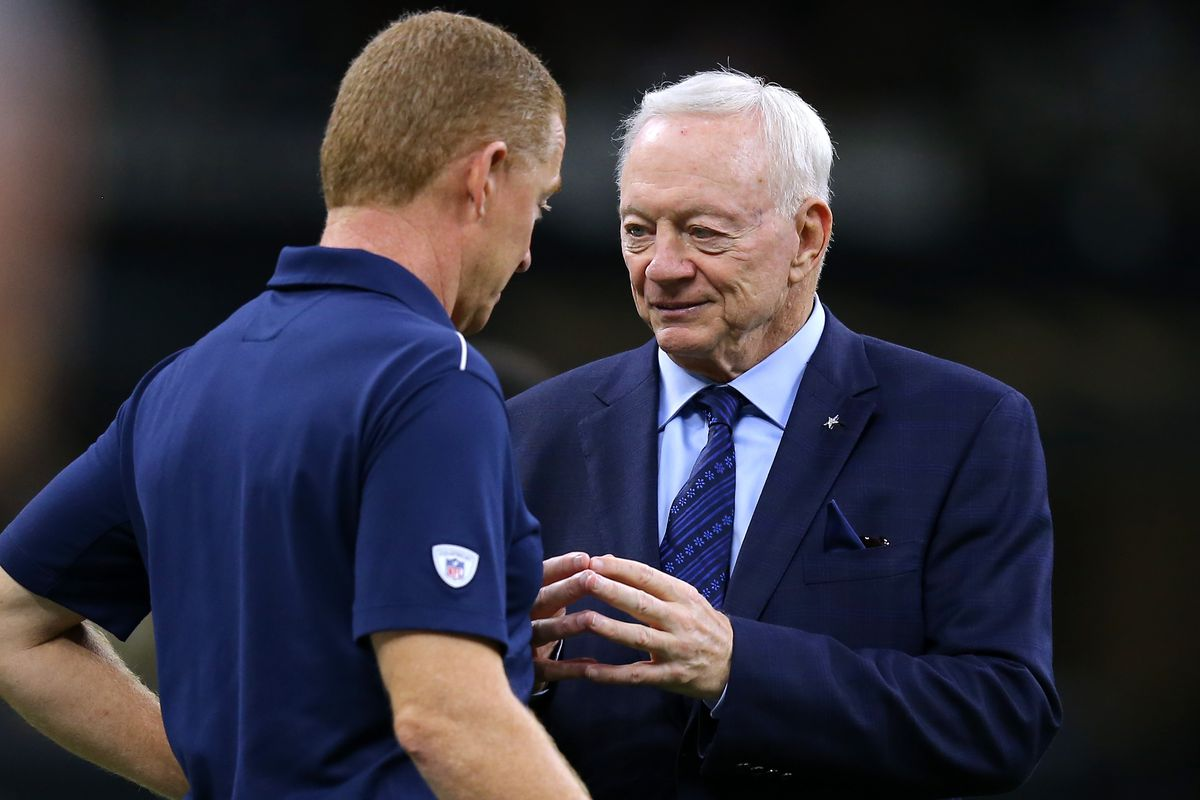 Jerry Jones owner of the Dallas Cowboys talks to head coach Jason Garrett before a game against the New Orleans Saints at the Mercedes Benz Superdome on September 29, 2019 in New Orleans, Louisiana.