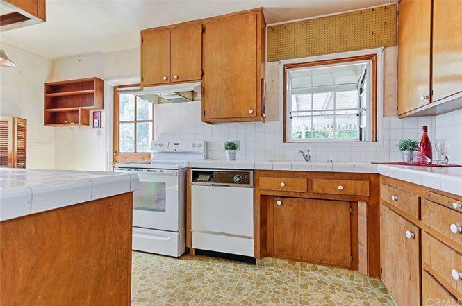 Kitchen with wooden cabinetry
