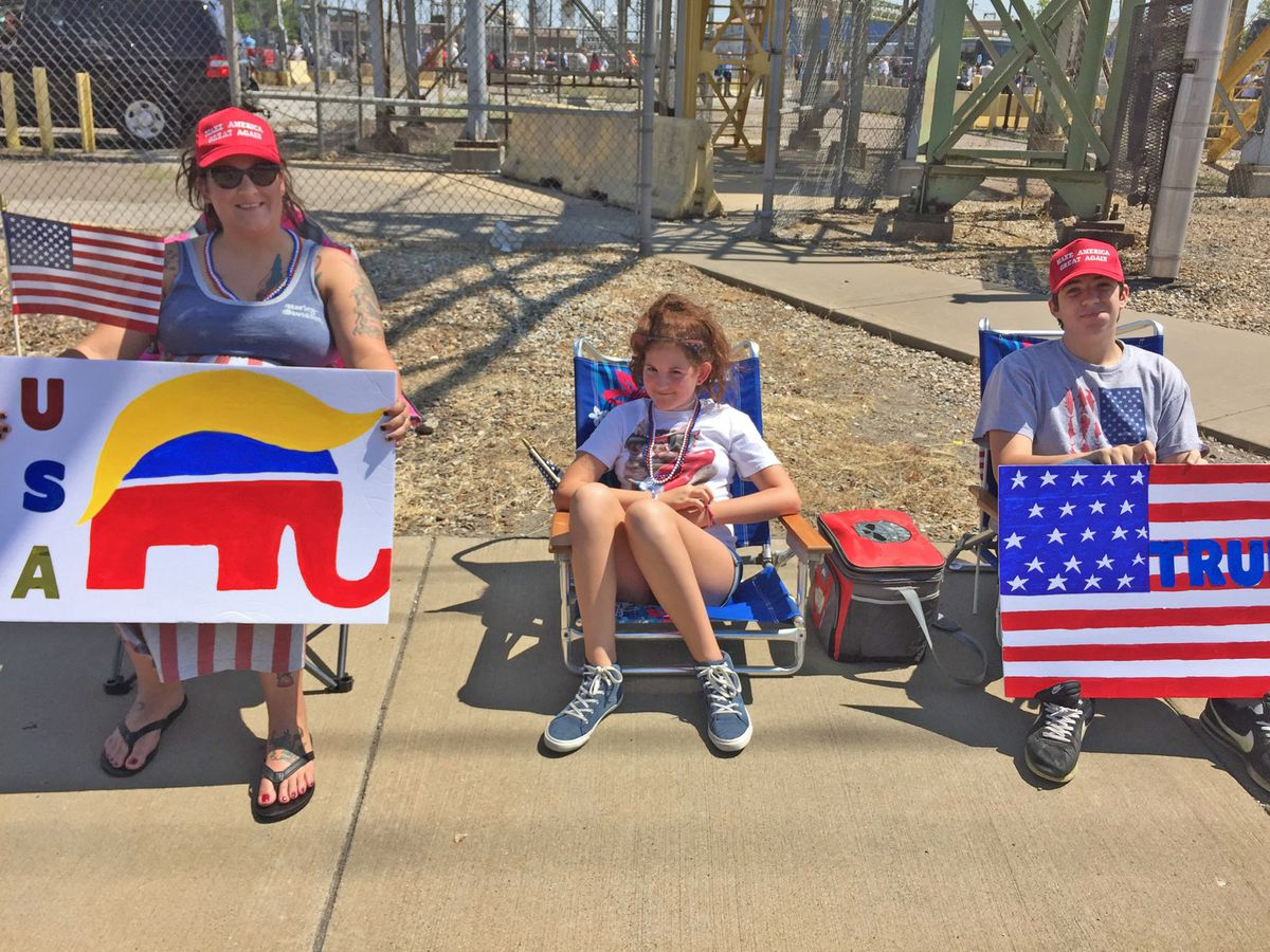 """Sara Cox and her children, Gavin and Annabelle, wait at the gates of U.S. Steel in Granite City to welcome President Trump. """"He's reviving the steel industry,"""" Cox said. 