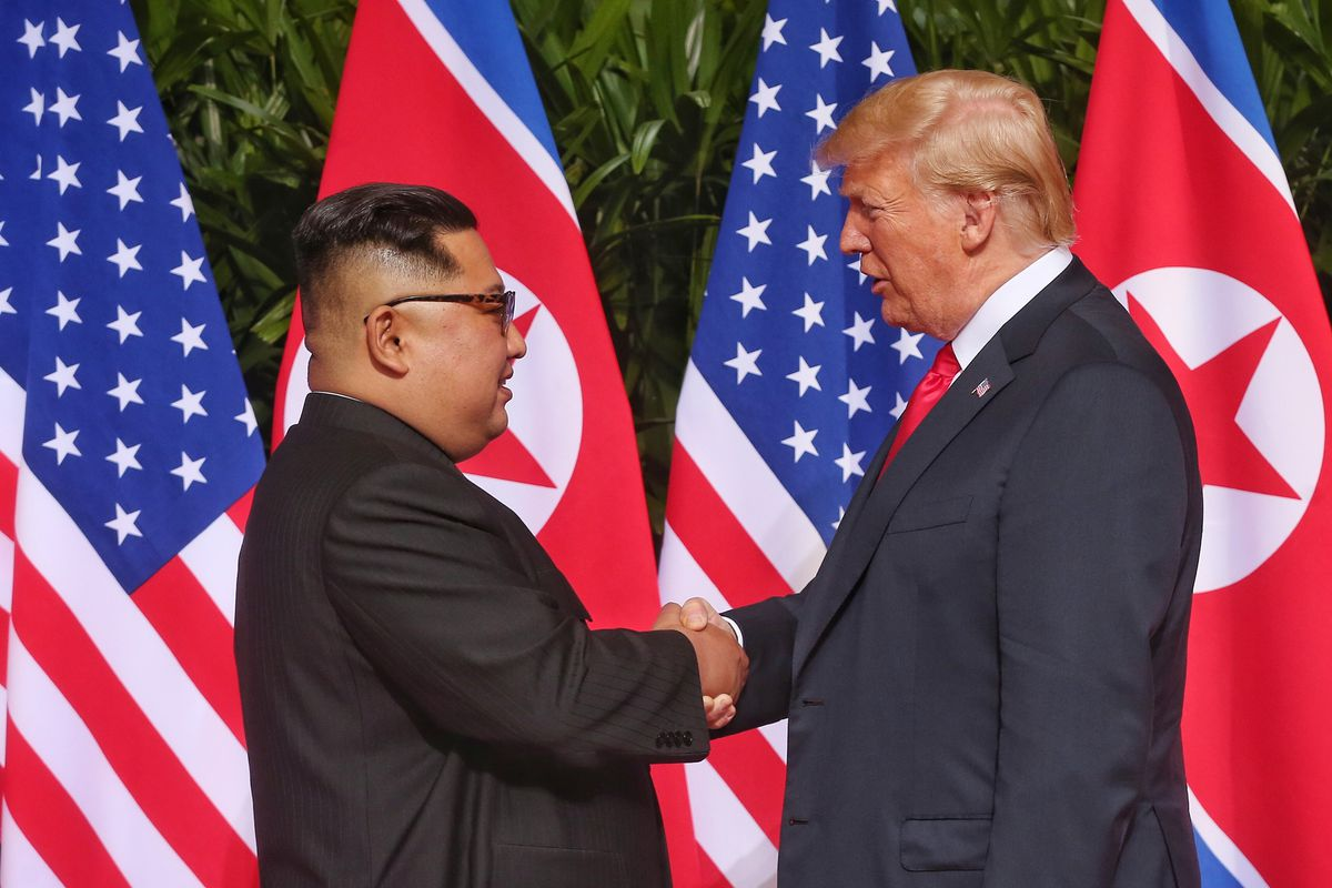 North Korean leader Kim Jong-un shakes hands with President Donald Trump during their historic summit on June 12, 2018 in Singapore.