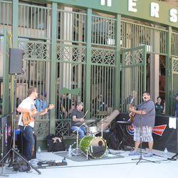 1:05 p.m. Band providing entertainment outside the bleacher gate -