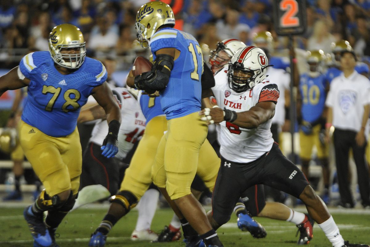 Nate Orchard (8), a terror to opposing quarterbacks, has helped his Utah team to a Top 25 ranking in both the major polls.