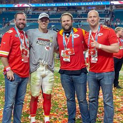 Kansas City's Daniel Sorensen poses on the field with his brothers following the Chiefs' Super Bowl victory over San Francisco.