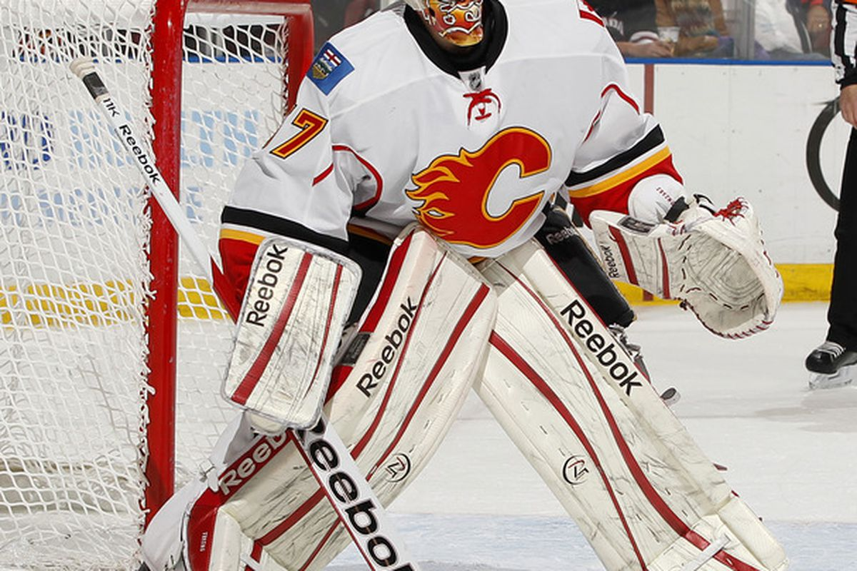 SUNRISE, FL - DECEMBER 16: Goaltender Leland Irving of the Calgary Flames defends the net against the Florida Panthers on December 16, 2011 at the BankAtlantic Center in Sunrise, Florida.  (Photo by Joel Auerbach/Getty Images)
