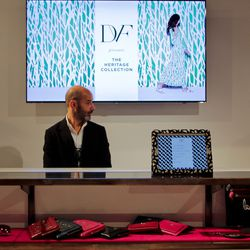 """Videos of the brand run on repeat behind the register, from a time lapse of what went down during the construction of """"Journey of a Dress"""" to an artsy video of models painted in DVF prints moving across the exhibit's patterned walls."""