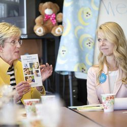 Sister Rosemary M. Wixom, the LDS Church's general Primary president, speaks as justice center program director Susanne Mitchell watches during a meeting at the Avenues Children's Justice Center on Tuesday, April 28, 2015, in Salt Lake City.
