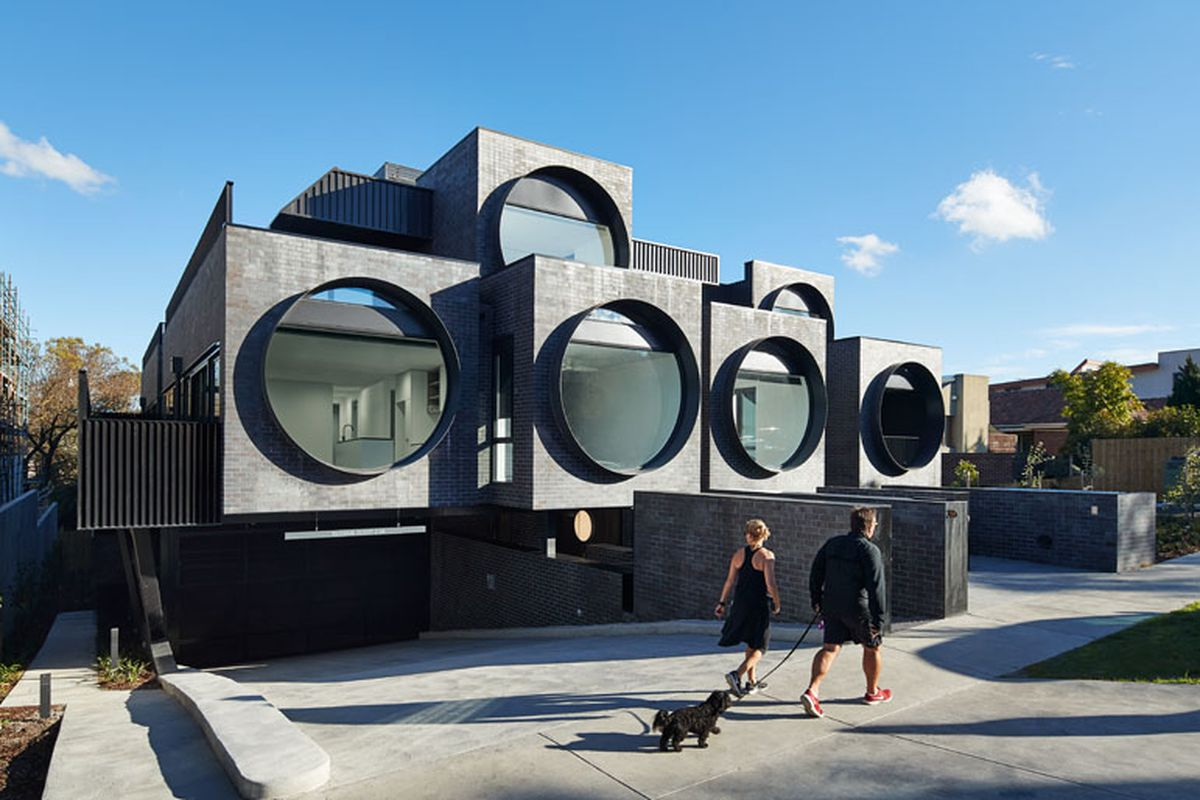 Modern apartment building overlooks street with six \'eyes ...