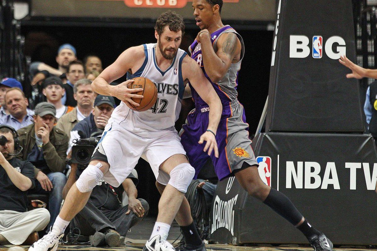 Apr 9, 2012; Minneapolis, MN, USA: Minnesota Timberwolves forward Kevin Love (42) drives to the basket past Phoenix Suns center Channing Frye (8) in the second half at Target Center The Suns won 114-90. Mandatory Credit: Jesse Johnson-US PRESSWIRE