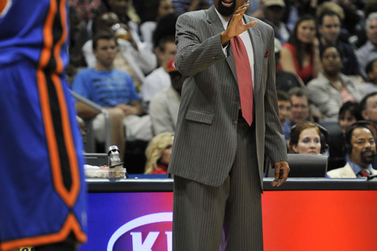 Mar 30, 2012; Atlanta, GA, USA; New York Knicks head coach Mike Woodson coaches shooting guard J.R. Smith (8) during the first half against the Atlanta Hawks at Philips Arena. Mandatory Credit: Paul Abell-US PRESSWIRE