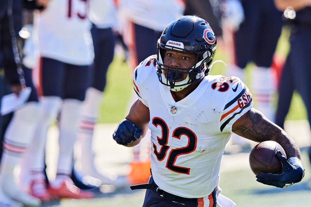 David Montgomery #32 of the Chicago Bears runs for yardage during the first quarter of a game against the Jacksonville Jaguars at TIAA Bank Field on December 27, 2020 in Jacksonville, Florida.