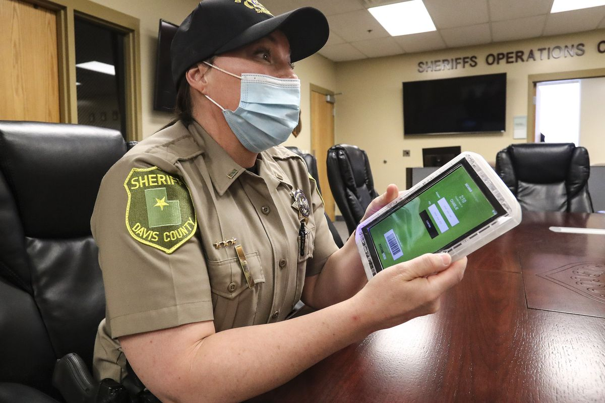 Davis County Sheriff's Lt. DeeAnn Servey holds a tablet that is issued to inmates when they're booked into jail while discussing the benefits of the device during an interview at the Farmington facility on Thursday, March 18, 2021.
