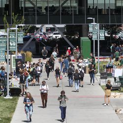 Students walk across campus between classes at Utah Valley University in Orem on Wednesday, Aug. 28,