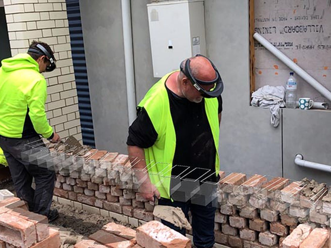 Bricklayers using Fologram with AR headsets.