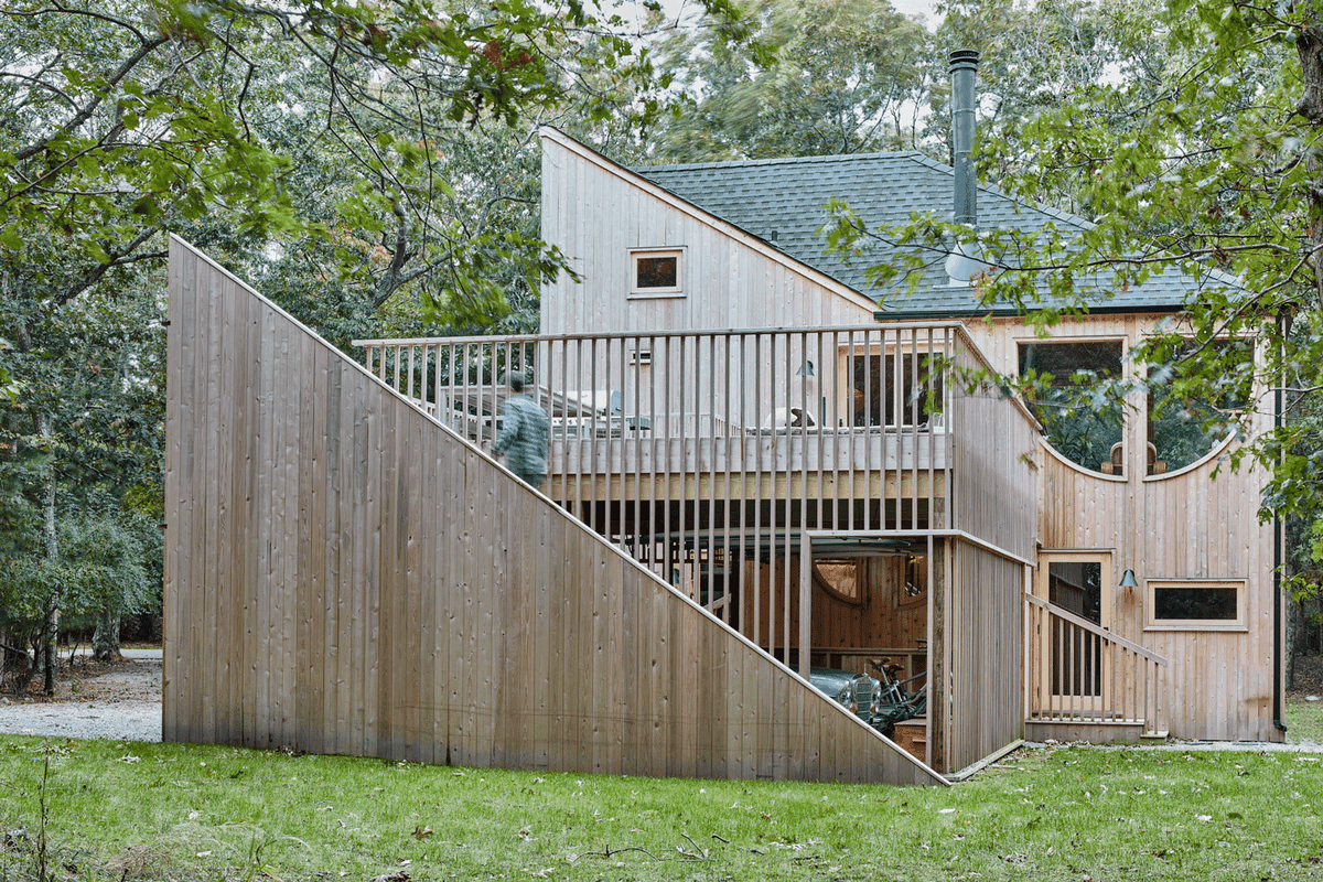 Man walking up staircase to deck.