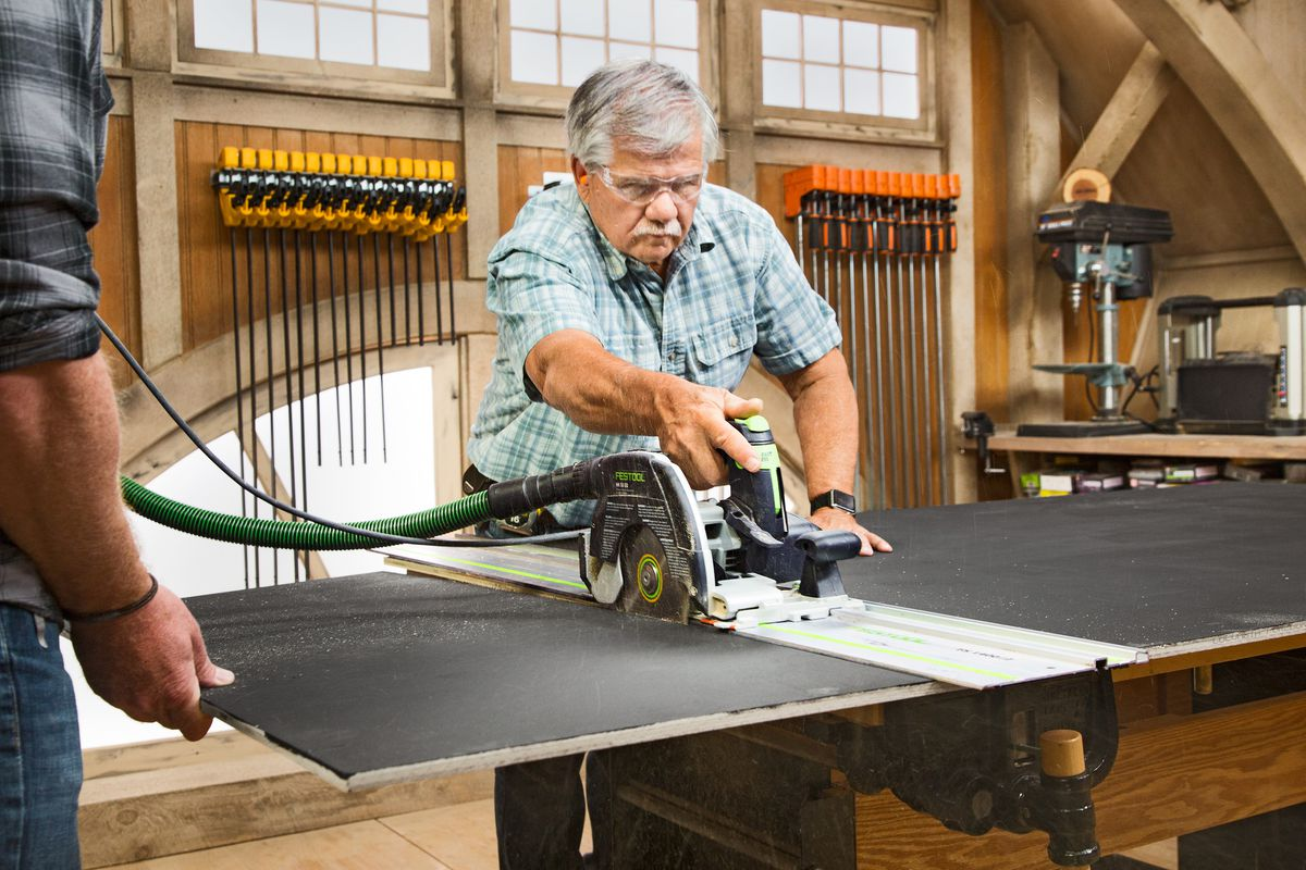 Tom Silva Cutting Back Of Piece Of Plywood