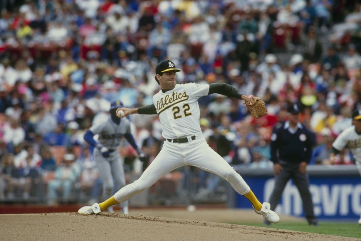Pitcher Scott Sanderson of the Oakland Athletics pitches during a  game against the Seattle Mariners. In 1985, he was pitching for the Cubs, but there are no photos in our Getty archive of that. (Photo by: Otto Greule Jr/Getty Images)