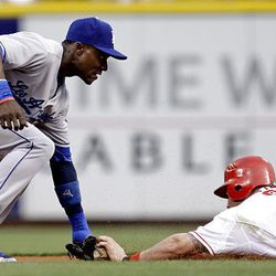 Cincinnati Reds' Jonny Gomes (31) is tagged out trying to steal second by Los Angeles Dodgers second baseman Orlando Hudson.
