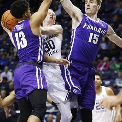 Brigham Young Cougars guard TJ Haws (30) drives on Portland Pilots guard Franklin Porter (13) in Provo on Thursday, Dec. 28, 2017.