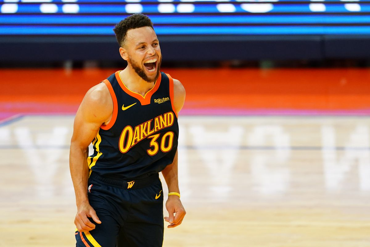 Stephen Curry of the Golden State Warriors reacts to a three point basket during the game against the Houston Rockets at the Chase Center on April 10, 2021 in San Francisco, California.