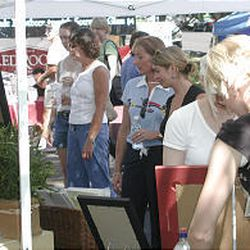 People look at merchandise during the Avenues Street Fair. Fair organizers say they expect roughly 15,000 Salt Lake City residents to attend the annual event Saturday, Sept. 10, 2005, \— roughly the same number that turned out two years ago when the fair was held on another section of South Temple.
