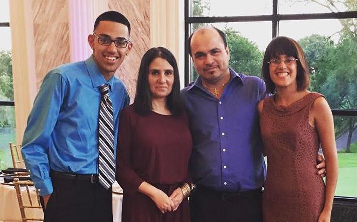 Mateo Avila, 22, of Little Village, with his family at NIU's Top Shelf Sports show, where he is associate producer. His mother, Saphia Avila (left), his father, Ramiro Avila, and his sister, Adriana Avila.   Provided photo