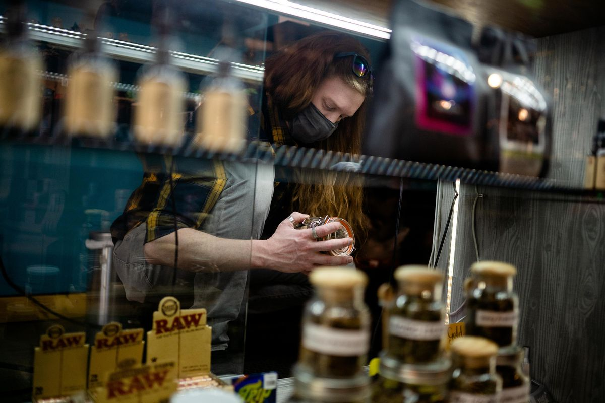 Jeff Trout, general manager of Botanic Alternatives, arranges products in the shop in the Logan Square neighborhood, Thursday afternoon, April 8, 2021.   Pat Nabong/Sun-Times