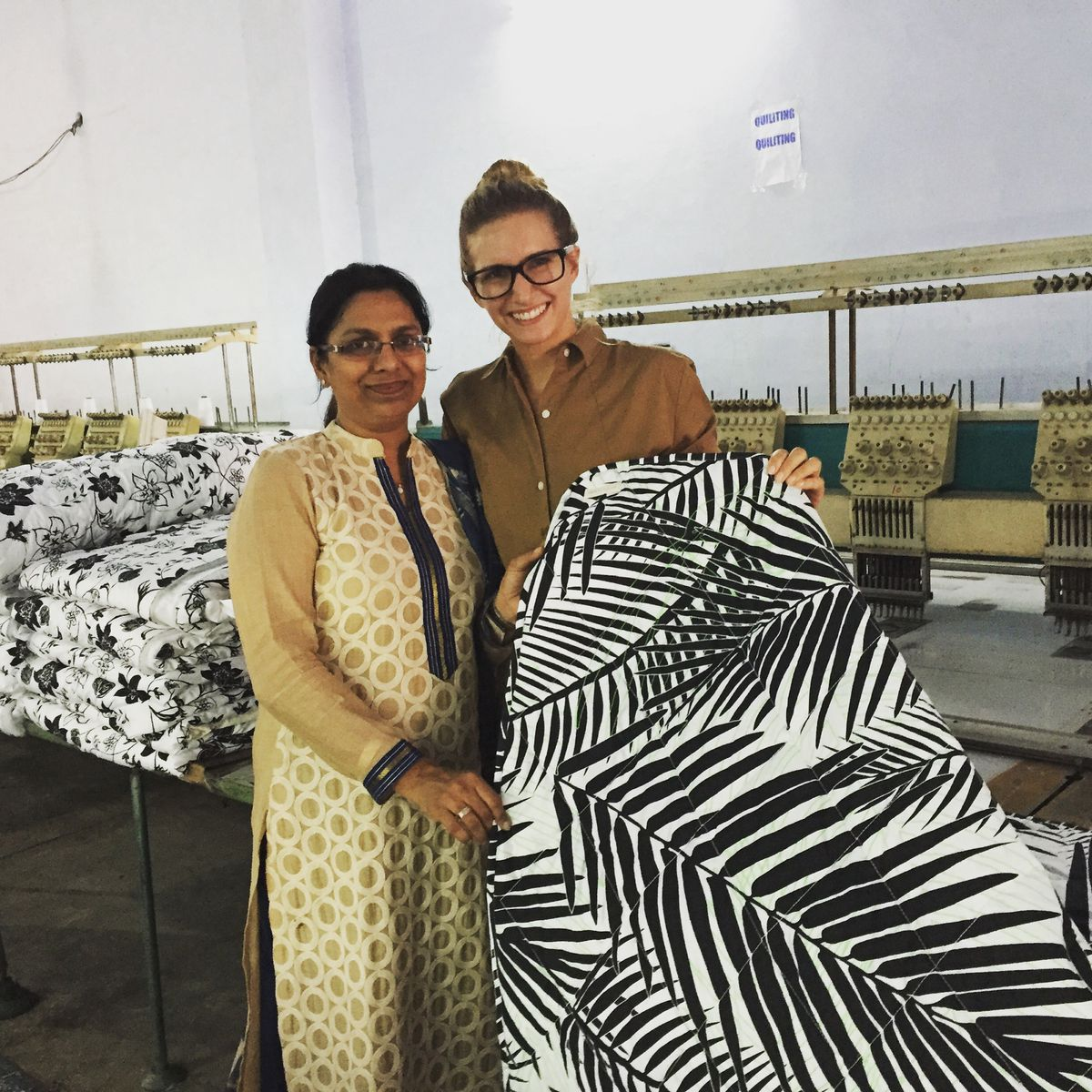 Tracy Heller with the owner of the factory that makes Brooklyn Born products (Courtesy TracyHeller)
