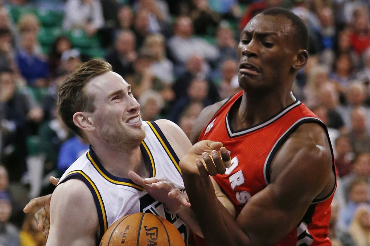 The Raptors' Bismack Biyombo (right) is not the most confident play today...