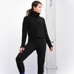 Cashmere turtleneck, $228; cashmere pants, $228; tights, $98