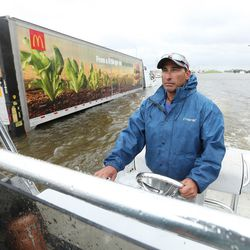 Mike Mazariegos drives his boat past a partially submerged truck during Tropical Storm Harvey in Houston on Tuesday, Aug. 29, 2017.