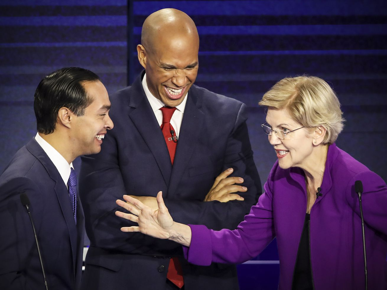 Former HUD Secretary Julián Castro, Sen. Cory Booker (D-NJ), and Sen. Elizabeth Warren (D-MA) during the first night of the Democratic presidential debate on June 26, 2019, in Miami.