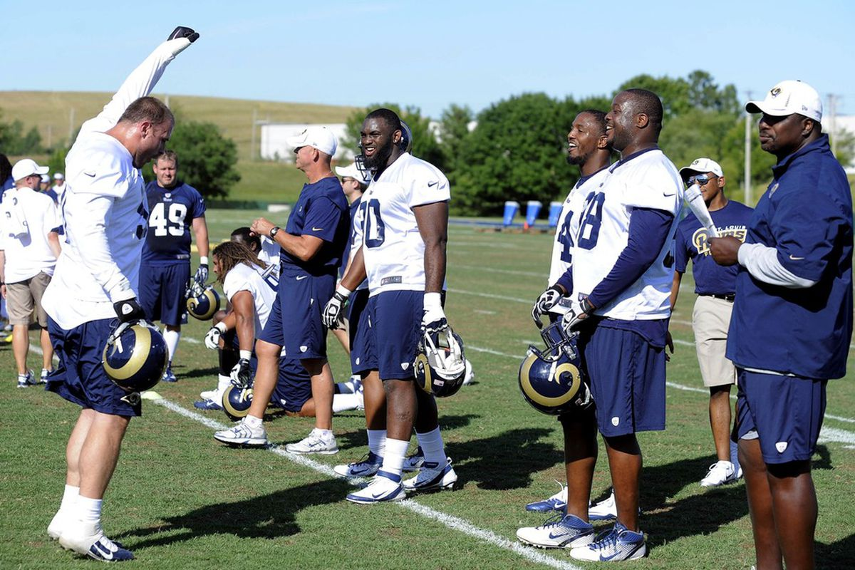 June 12, 2012; St. Louis, MO, USA; St. Louis Rams defensive end Chris Long (91) jokes around with teammates during minicamp at ContinuityX Training Center. Mandatory Credit: Jeff Curry-US PRESSWIRE