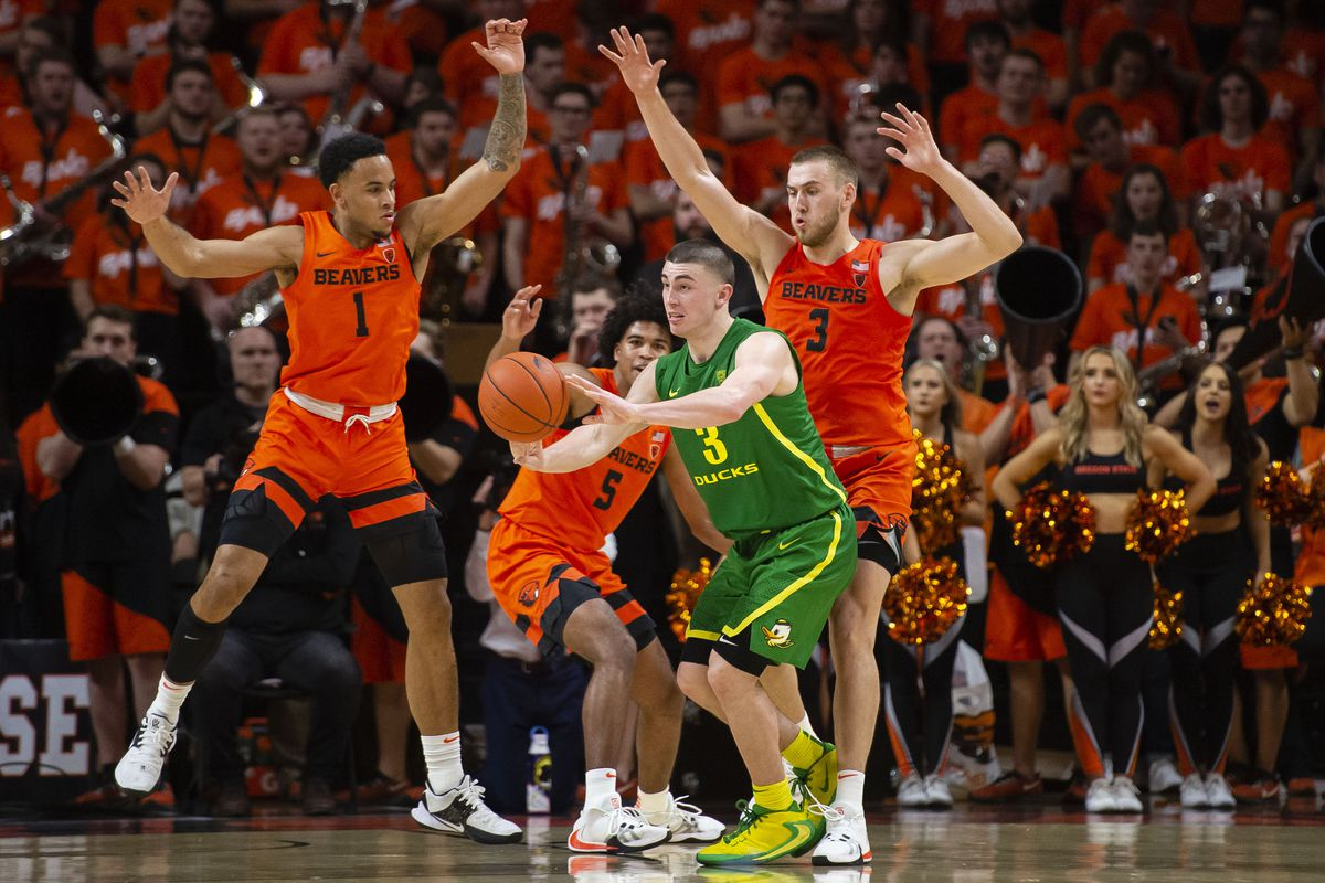 Oregon State Beavers guard Sean Miller-Moore and guard Ethan Thompson and forward Tres Tinkle pressure Oregon Ducks guard Payton Pritchard during the second half at Gill Coliseum. The Beavers won 63-53.