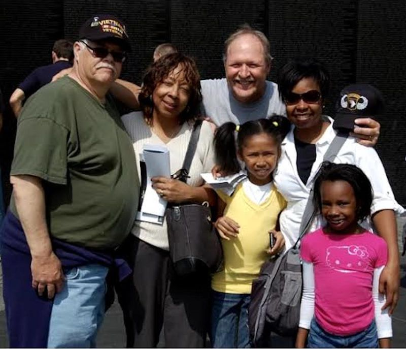 After 40 years of searching, Jim Zwit (rear center) finally found relatives of his war buddy William J. Ward while visiting the Vietnam Veterans Memorial in Washington, D.C.: Lois Daniels (in V-neck shirt, holding papers), her granddaughters Charity and Taelor and daughter Kelly. Fellow vet Bob Gervasi is at left.