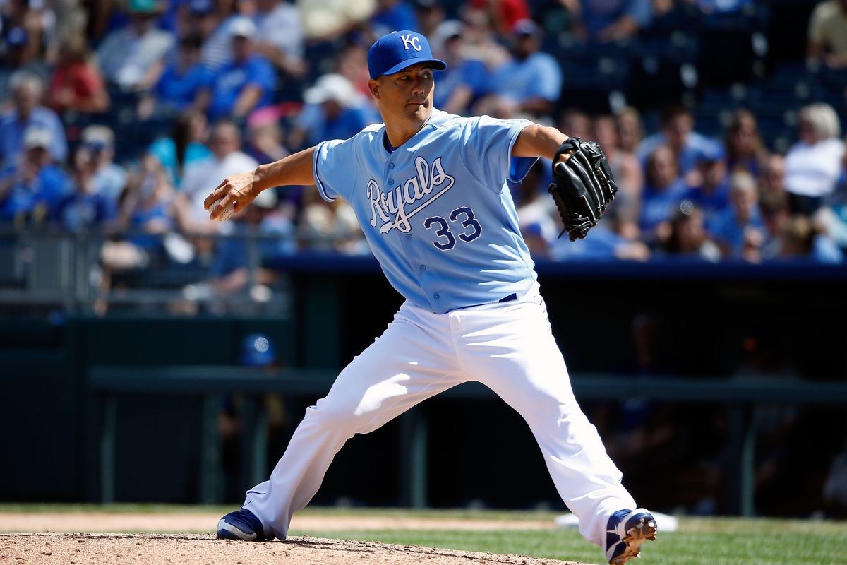 KANSAS CITY, MO - AUGUST 19:  Starting pitcher Jeremy Guthrie #33 of the Kansas City Royals in action during the game against the Chicago White Sox at Kauffman Stadium on August 19, 2012 in Kansas City, Missouri.  (Photo by Jamie Squire/Getty Images)