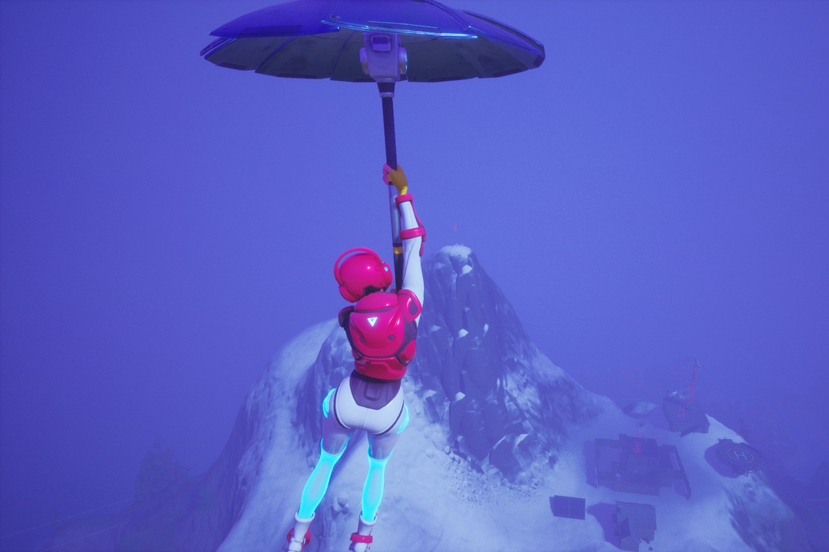 A Fortnite player gliding in toward a mountain