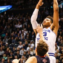 Brigham Young Cougars forward Yoeli Childs (23) pulls up and shoots over Saint Mary's Tanner Krebs (00) as the BYU Cougars take on the Saint Mary's Gaels in the Marriott Center in Provo on Saturday, Dec. 30, 2017.