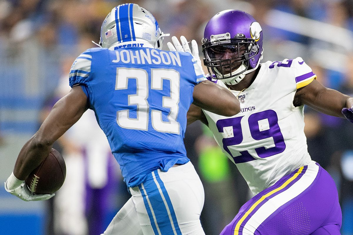 Kerryon Johnson of the Detroit Lions runes for a short gain as Xavier Rhodes of the Minnesota Vikings gets ready to make the top during the first quarter of the game at Ford Field on October 20, 2019 in Detroit, Michigan.