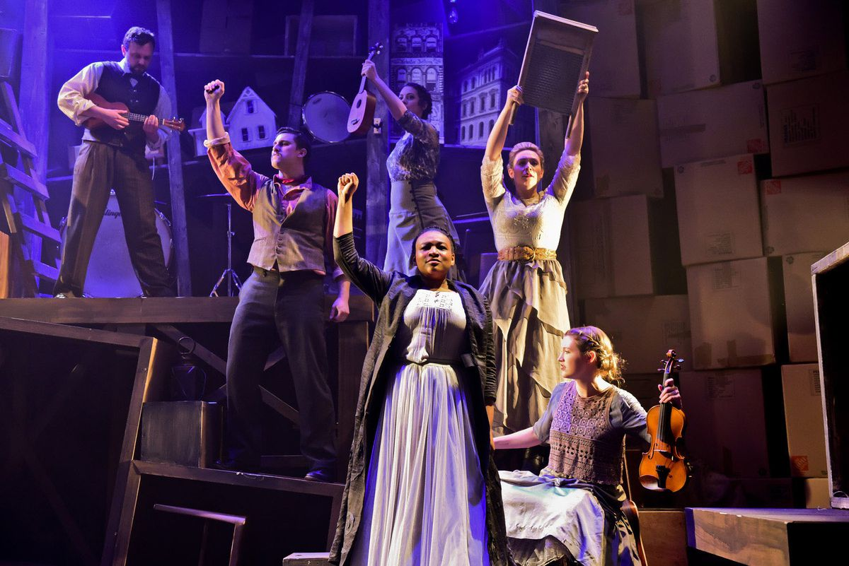 """LaKecia Harris (front) stars as Lucy Parsons, with the cast of the Underscore Theatre world premiere of """"Haymarket: The Anarchist's Songbook."""" (Photo: Evan Hanover)"""