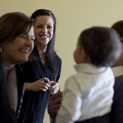 Mary Jo Mcmillan, executive director of Utah Support Advocates for Recovery Awareness (USARA), plays with 1-year-old Max Puente as Max's mother, Erin Finkbiner, watches after a press conference at the Capitol in Salt Lake City on Friday, Jan. 29, 2016, where legislators presented a group of bills targeted at the opioid overdose crisis that is sweeping the state. Finkbiner is a recovering herion addict. Once she learned she was pregnant with Max she turned her life around.