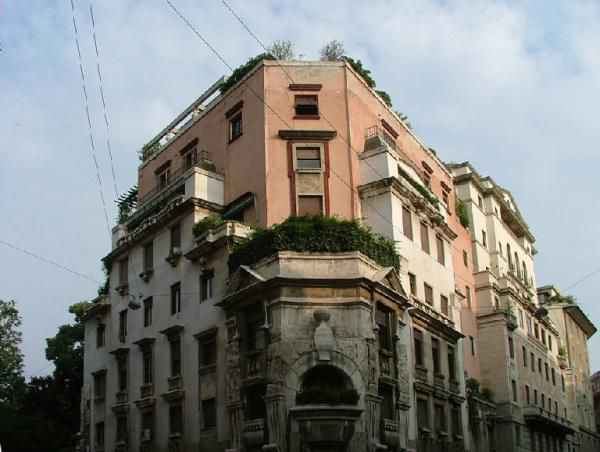 The exterior of Palazzo Sola Busca in Milan. The building has multiple levels, windows, and an entrance with an arched doorway.
