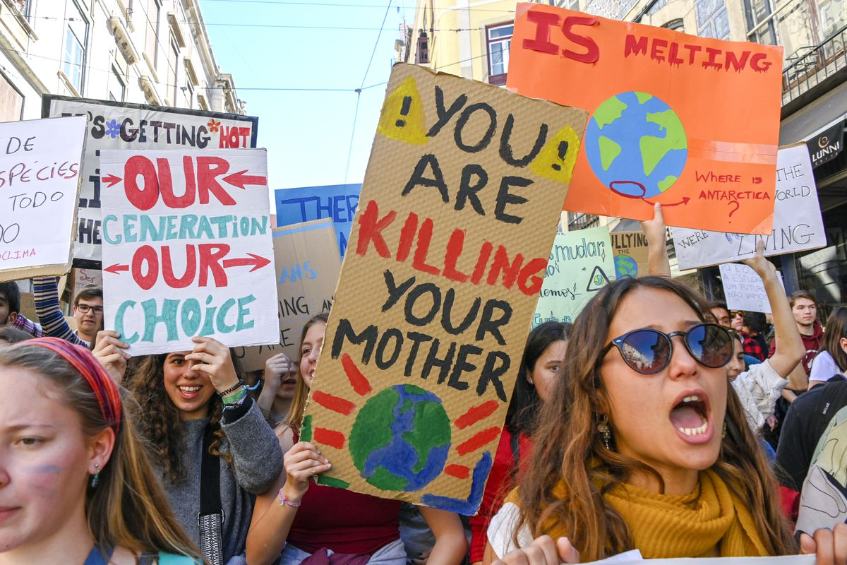 Portuguese students chant and hoist placards in front of the Assembleia da Republica (Portuguese Parliament) during their demonstration to support actions for climate change on March 15, 2019 in Lisbon, Portugal.