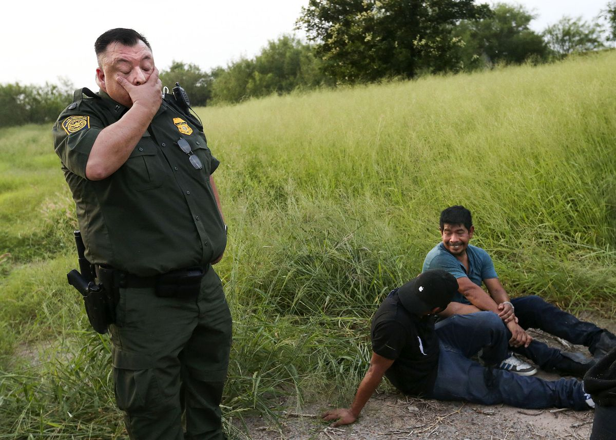 Supervisory Border Patrol agent and Rio Grande Valley sector chaplain Robert Hess questions undocumented migrants in Texas.