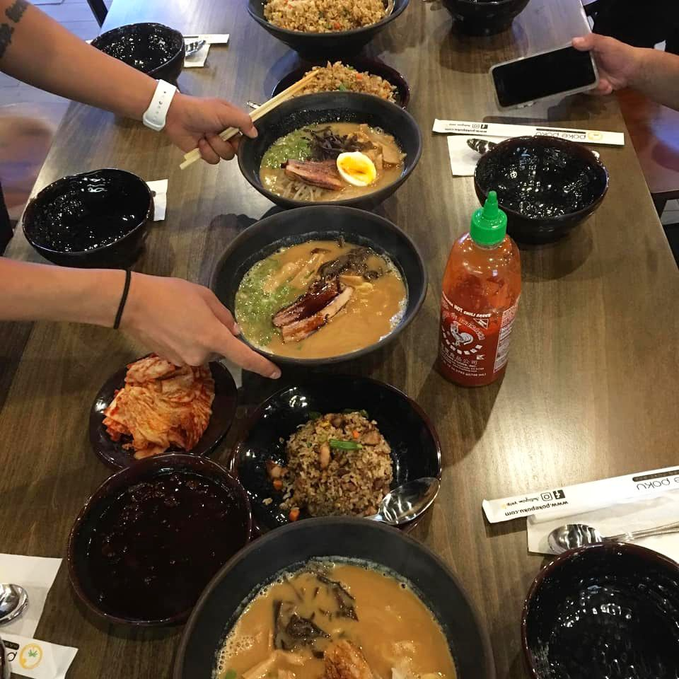 A table filled with rice and ramen dishes at new Henderson restaurant, Enza Ramen
