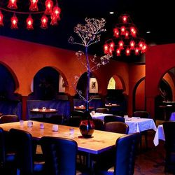 With its heavy iron chandeliers hanging from wood-beamed ceilings and rounded arches,  Aziza's sexy yet sophisticated approach to dining temporarily transports you to Morocco all without having to leave the fog. The decor arftully incorporates tables tuck
