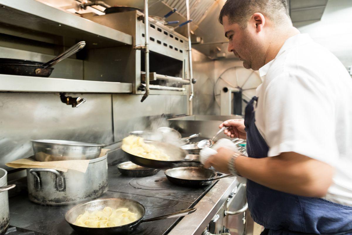 Freedom Rains cooking pasta
