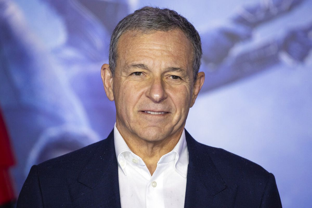 """Chairman and Chief Executive Officer (CEO) of The Walt Disney Company Bob Iger poses for photographers upon arrival at the premiere for the film """"Star Wars: The Rise of Skywalker,"""" in central London, Wednesday, Dec. 18, 2019."""