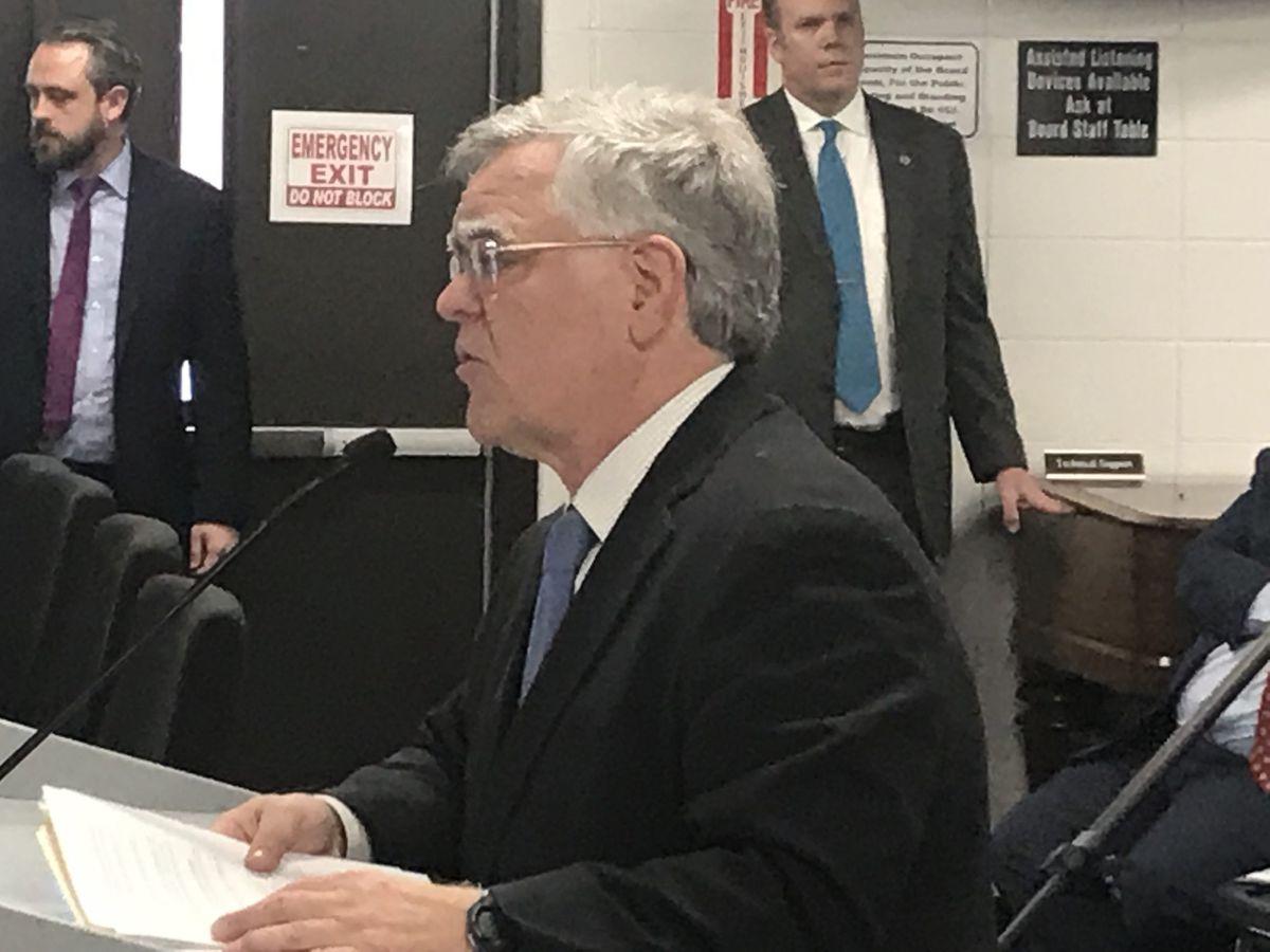 Mayor John Cooper announces the lawsuit to school board members in Nashville.