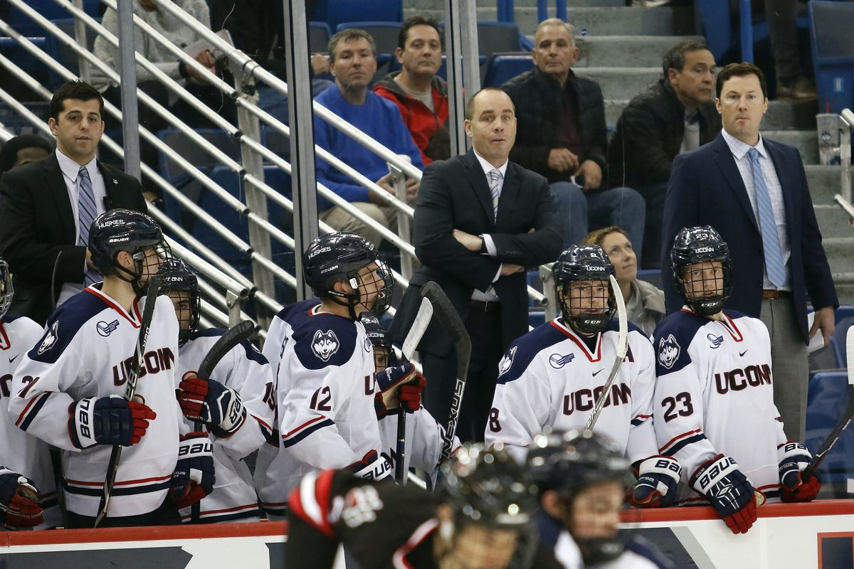 UConn assistant coach Joe Pereira, UConn head coach Mike Cavanaugh & UConn assistant coach Brendan Buckley during the Northeastern Huskies vs UConn Huskies men's college ice hockey game game at the XL Center in Hartford, CT  on November 28, 2017.