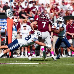 BYU linebacker Butch Pau'u, left, tries to tackle Mississippi State quarterback Nick Fitzgerald during the first half at Davis Wade Stadium in Starkville, Miss., on Saturday, Oct. 14, 2017.